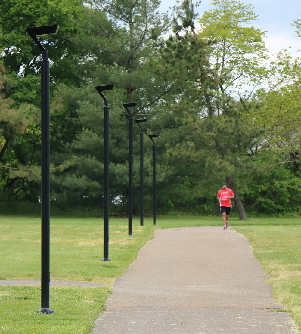 Man running beside pathway lighting - IPL Series - First Light Technologies