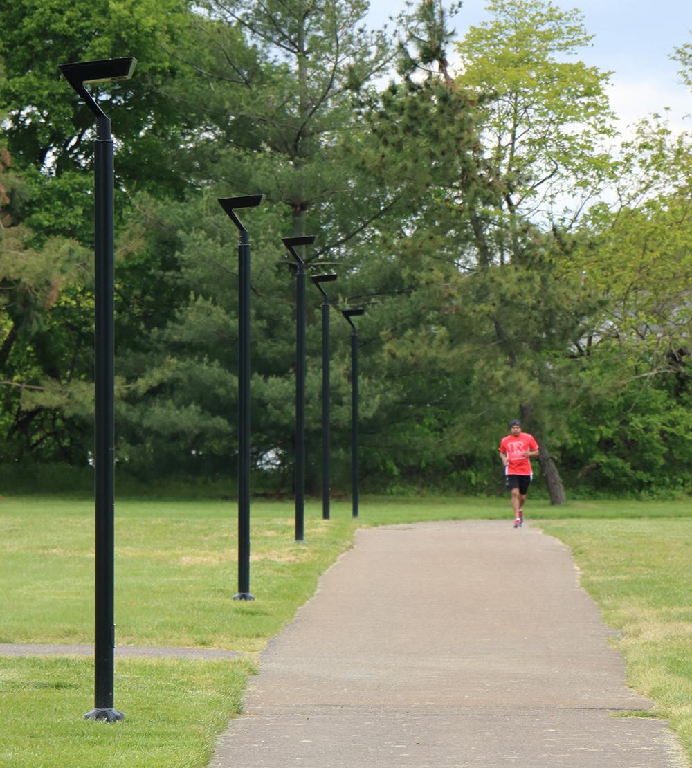 Man running beside pathway lighting - IPL Series - First Light Technologies